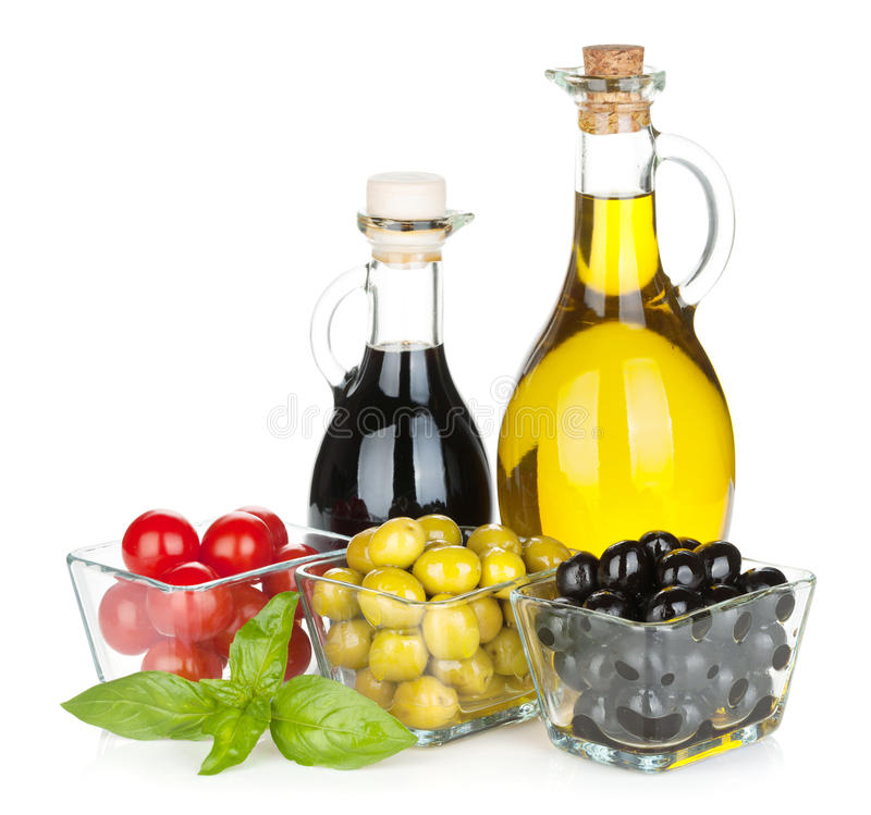 Oliv, tomater, örter och smaktillsatser royaltyfri fotografi