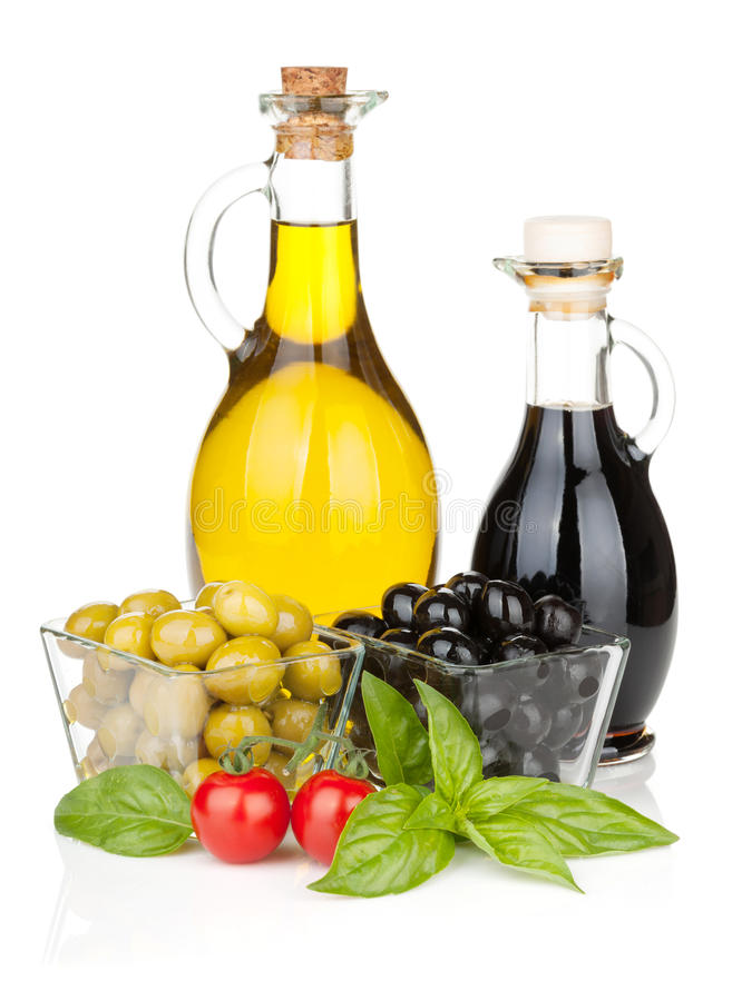 Oliv, tomater, örter och smaktillsatser royaltyfria bilder