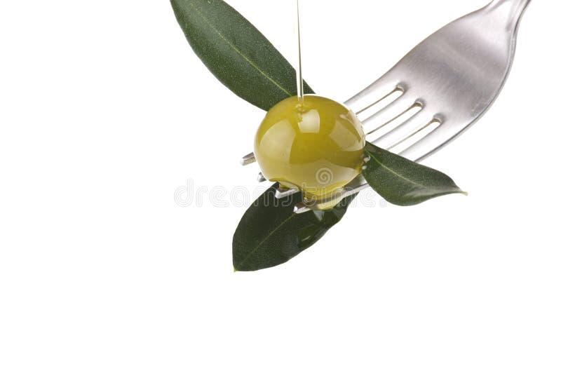 oliva con l'olio di goccia immagini stock libere da diritti