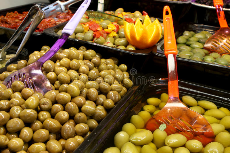 Olive bar. Containers with different kinds of olives royalty free stock image