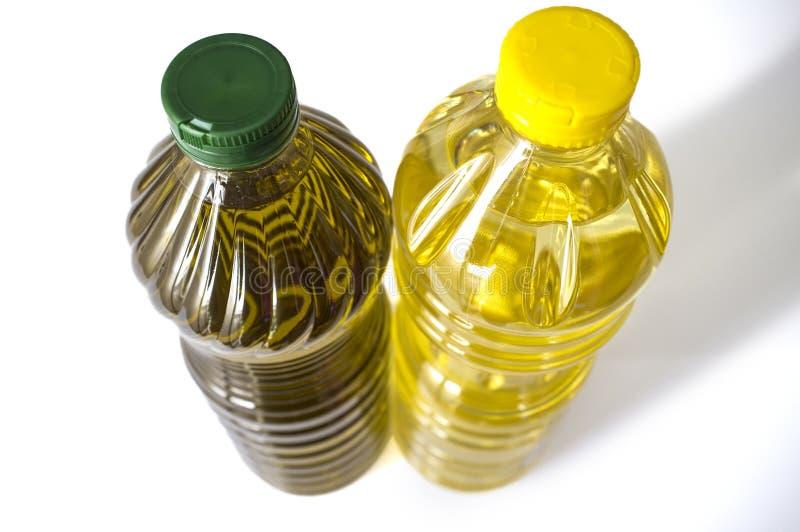 Olive contre l'huile de tournesol mis en bouteille dans l'ANIMAL FAMILIER Secteur supérieur photo stock