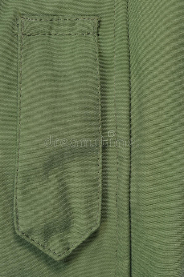 Olive Drab Green ECWCS Parka Rank Insignia Badge Loop Closeup, Blank Empty Vertical Apparel Background Copy Space, Front Placket. Storm Flap, Large Detailed royalty free stock photo