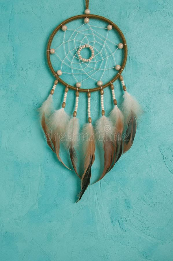 Olive dream catcher. On aquamarine textured background. Texture of concrete, copy space for text stock images