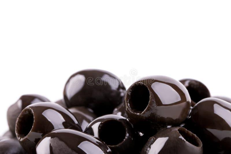Olive fresche appetitose senza pozzi su un fondo bianco immagine stock