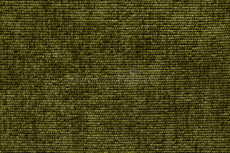 Olive green background from a soft textile material. sheathing fabric with natural texture. Cloth backdrop. Dark green background from a soft textile material royalty free stock photo