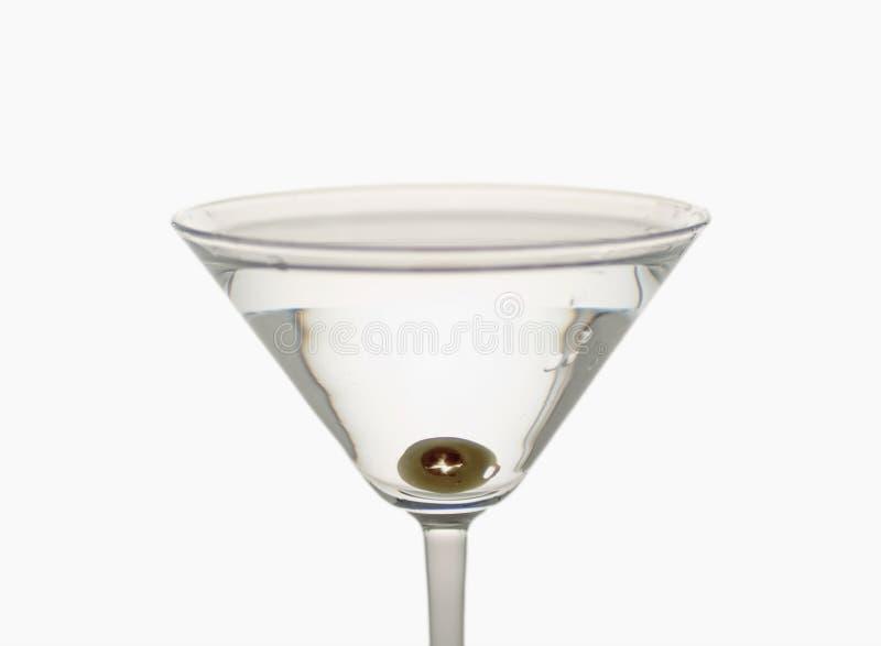 Olive im Cocktail stockfoto
