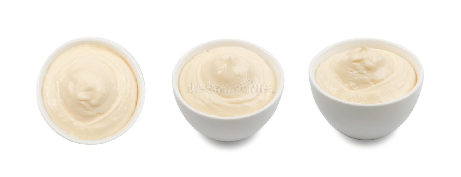 Olive Mayonnaise or Mayo Sauce in Small White Bowl Close Up stock photo
