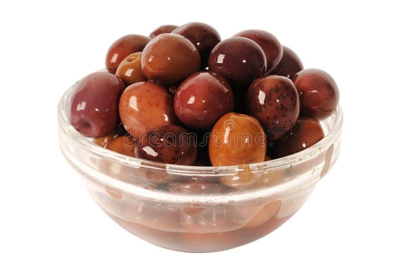 Olive nere di Kalamata in una ciotola fotografia stock