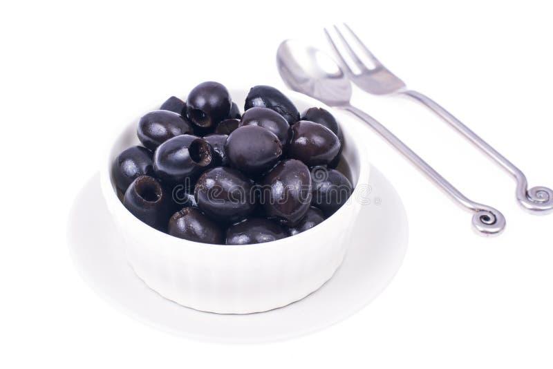Olive nere senza pozzi immagini stock