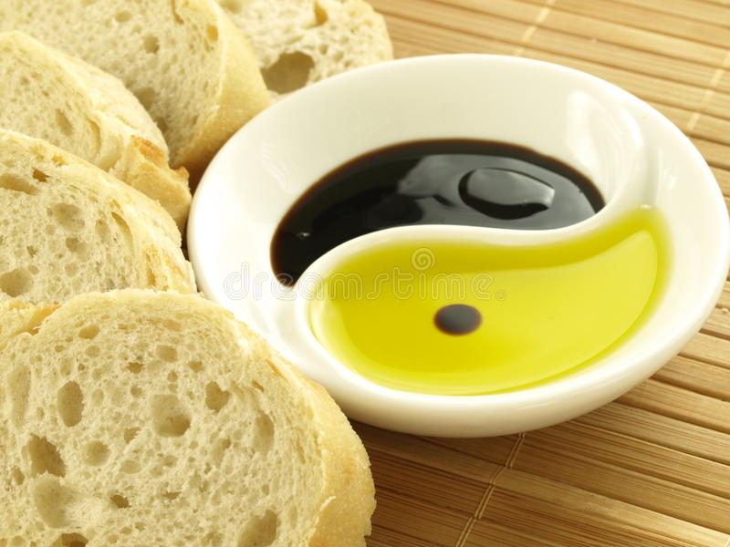 Olive oil with baguette stock photos