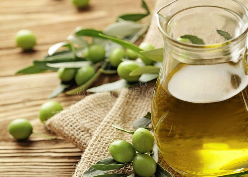 Olive oil. Bottle and green olives
