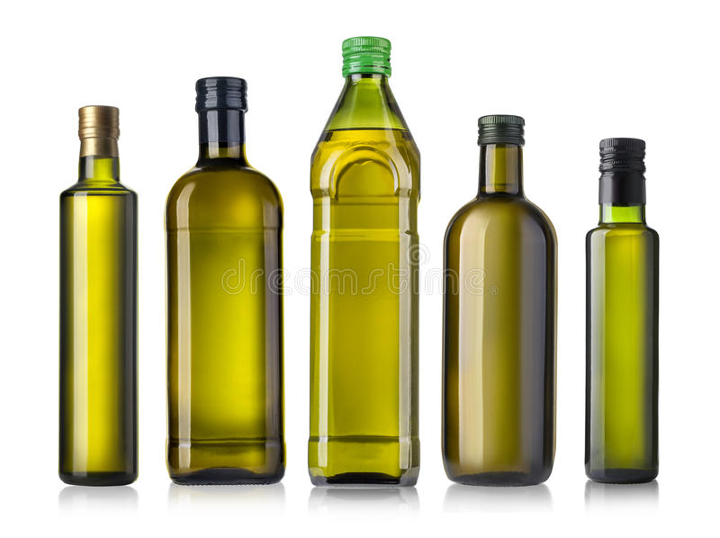 Olive oil bottle on white stock photography