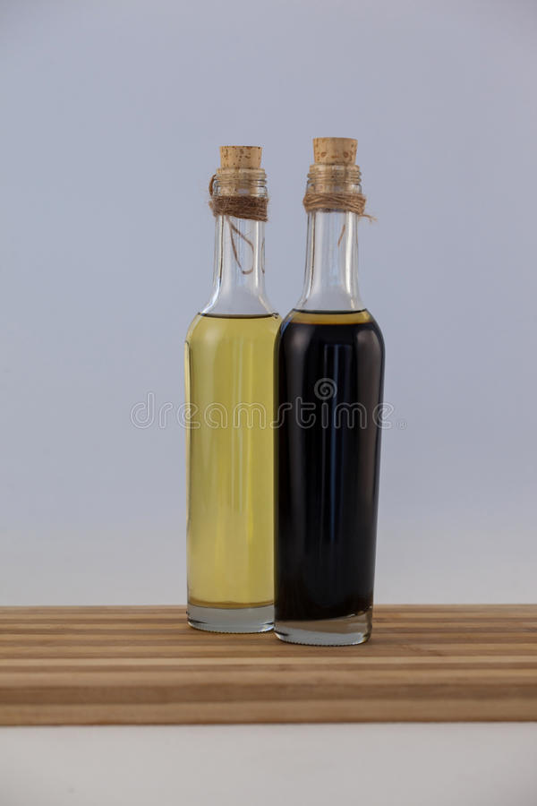 Olive oil in bottles on wooden table stock image
