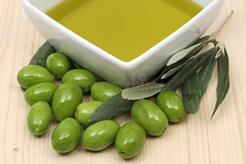 Olive oil in a bowl royalty free stock images