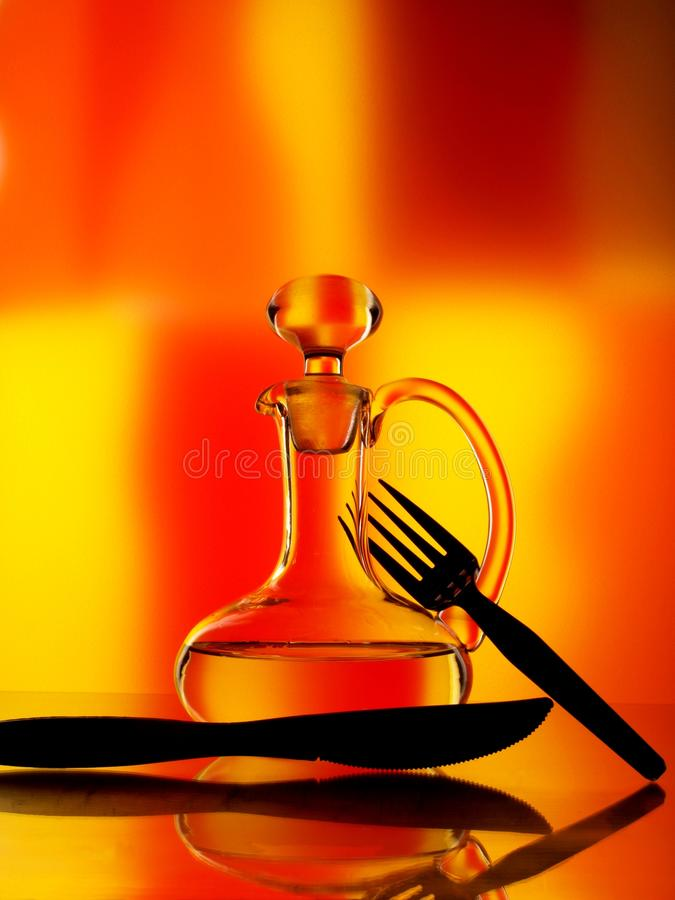 Olive Oil Cruet with Fork & Knife royalty free stock images