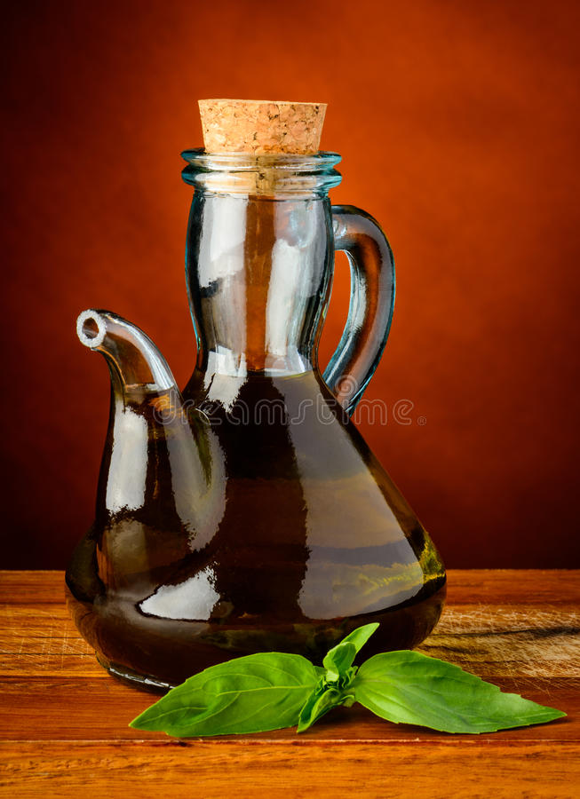 Olive oil and fresh green basil royalty free stock photo