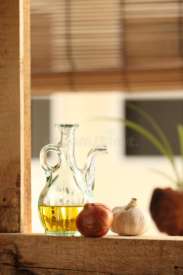 Olive oil with garlic and onion stock photo