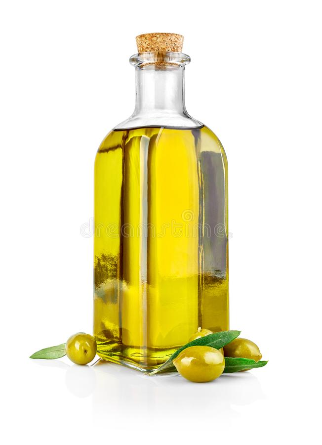 Olive oil in glass bottle with fresh olives. stock photo