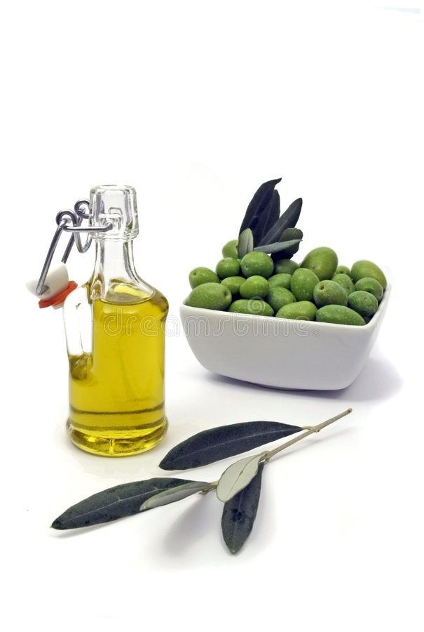 Olive oil and green olives royalty free stock photo