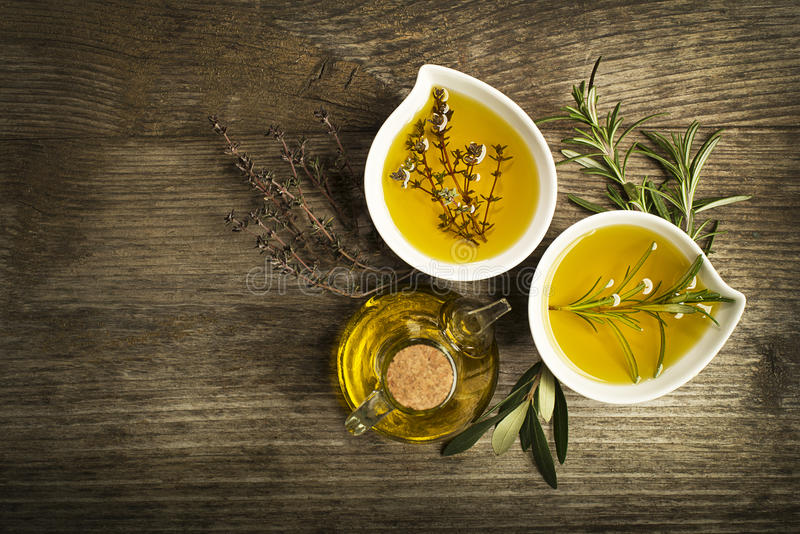 Olive oil with herbs stock photography