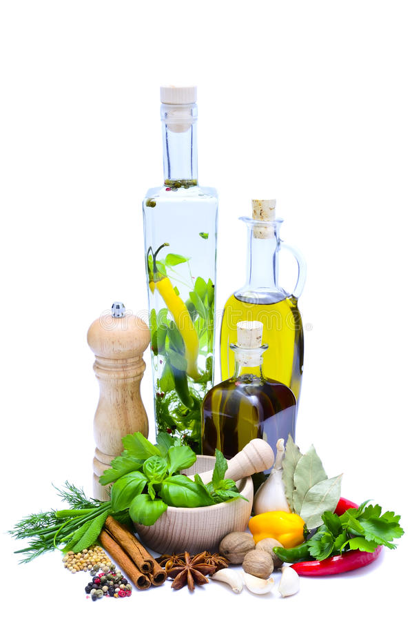 Olive oil, herbs and spices stock photography