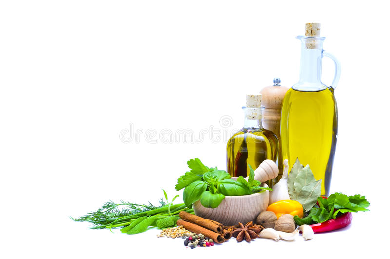 Olive oil, herbs and spices stock photo