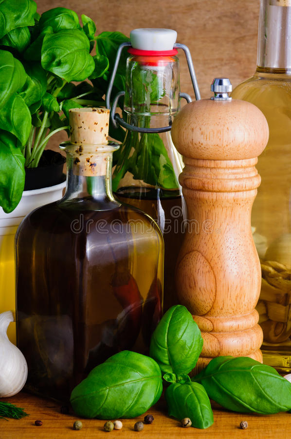 olive oil, herbs and spices stock images