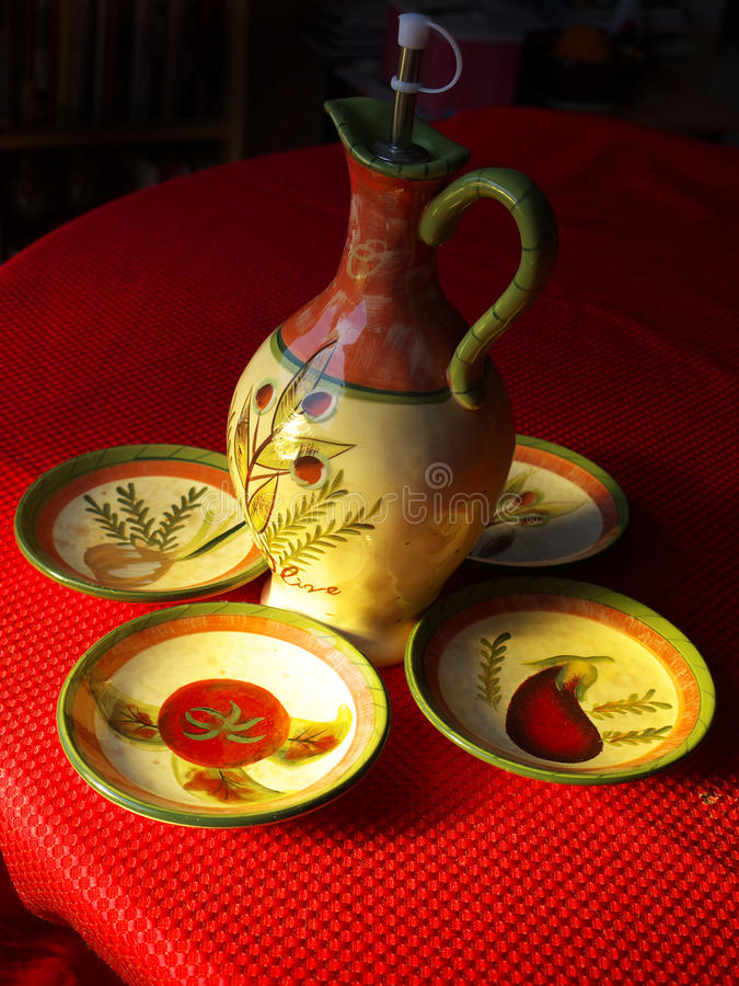 Free Olive Oil Jug With A Set Of 4 Plates Royalty Free Stock Images - 14210079