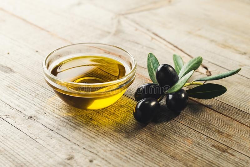 Olive oil with leaves and olives stock photo