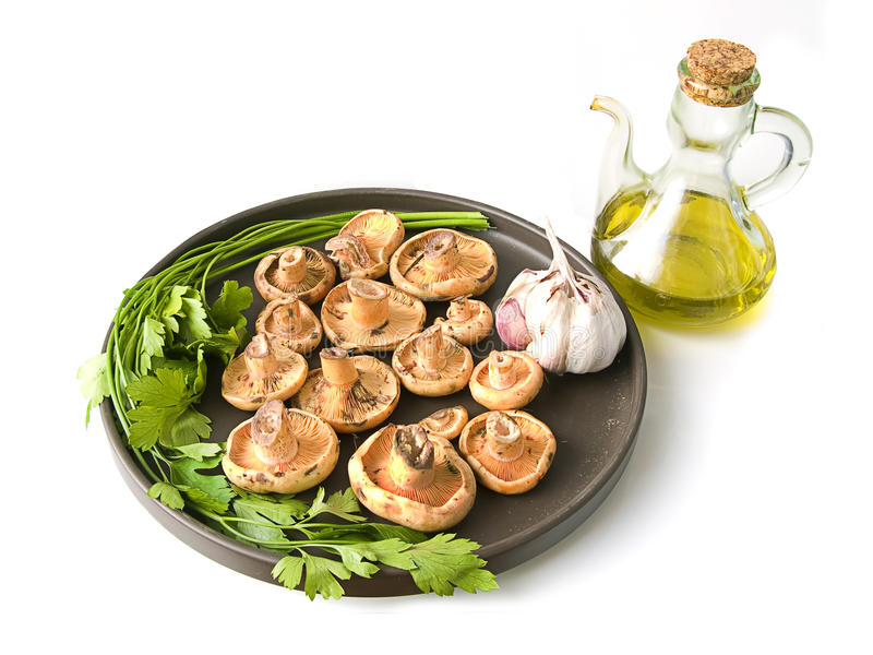 Olive oil and mushrooms with garlic and parsley royalty free stock photo