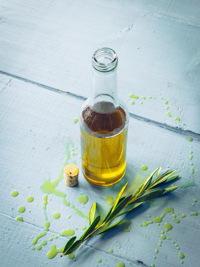 Olive oil with olive twig stock image