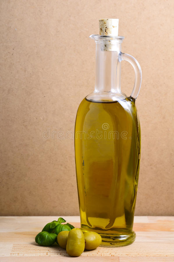 Olive oil and olives stock image