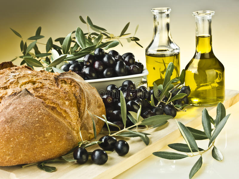 Olive oil and olives. In Italy stock photography