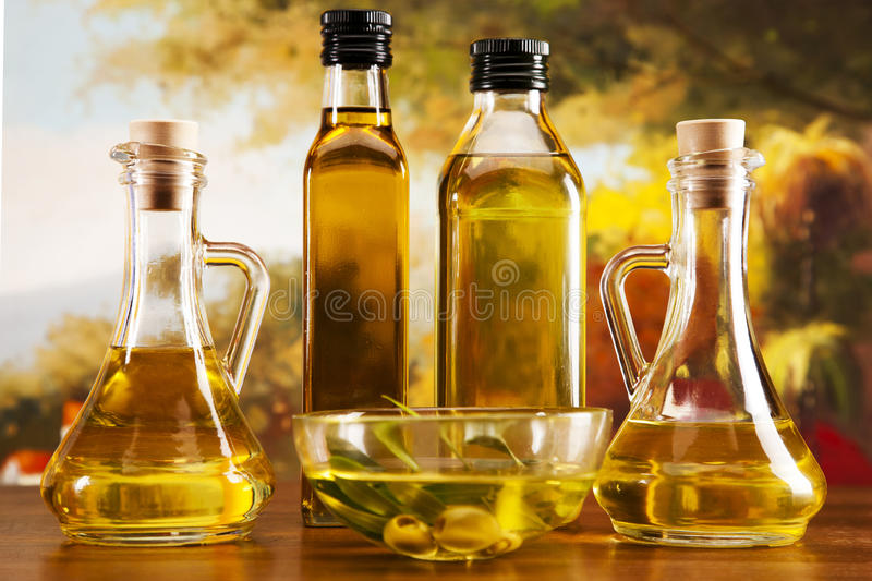 Olive oil and olives closeup stock photography