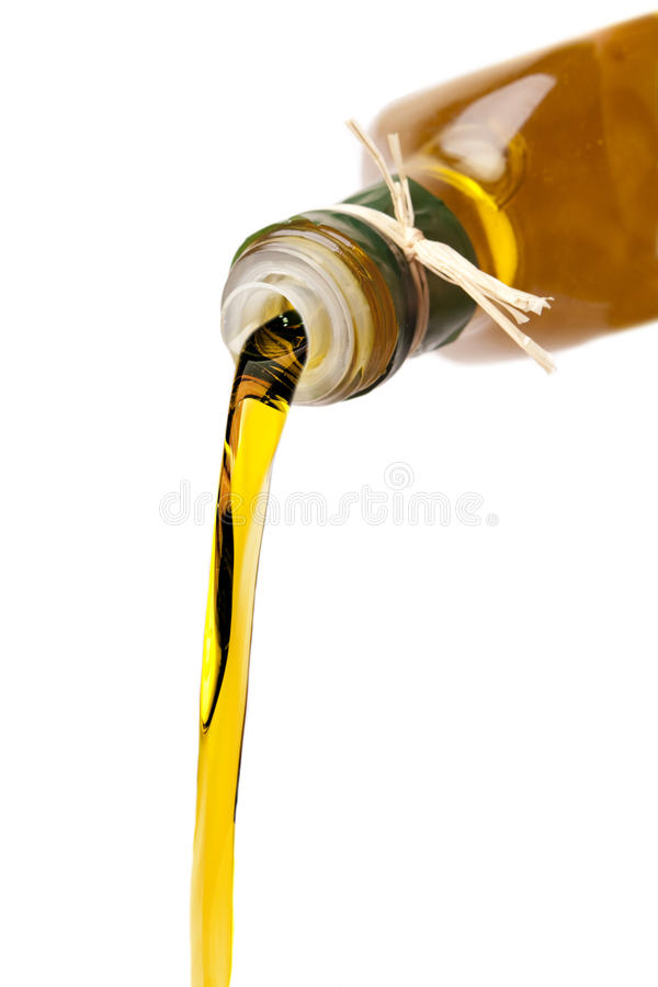 Olive Oil Poured royalty free stock images