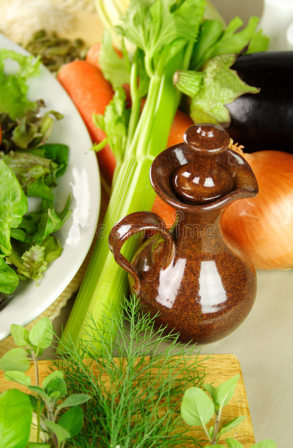 Olive Oil Pourer With Vegetables stock photo