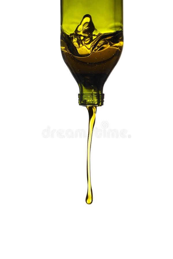 Olive oil pouring from green bottle stock photos