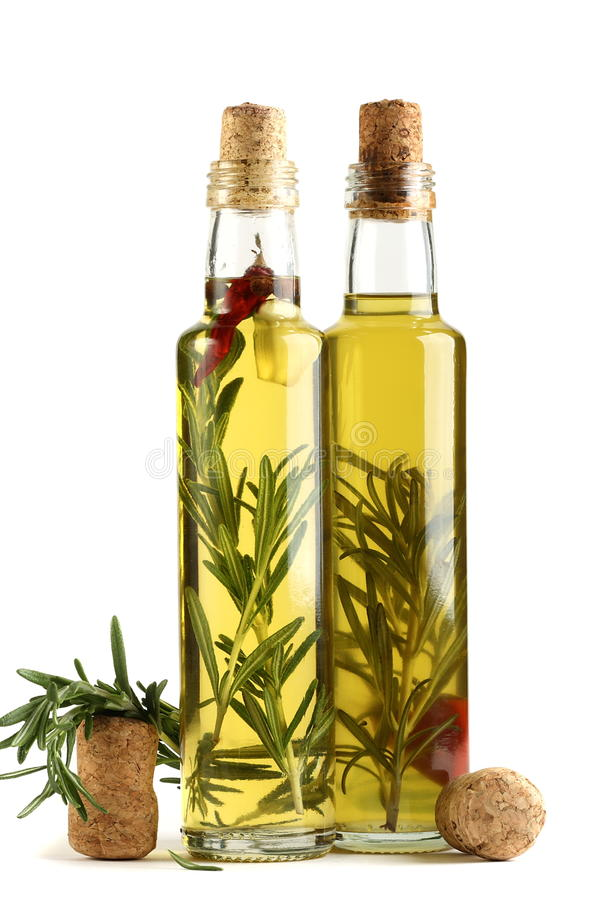 Olive oil with rosemary, garlic and pepper. royalty free stock photo