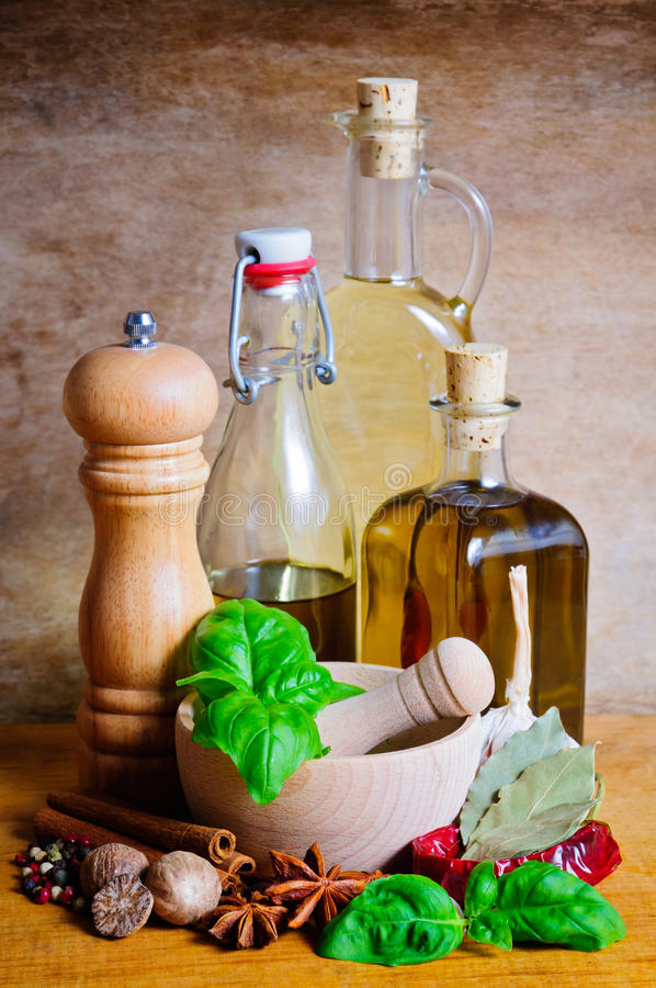 Olive oil and spices stock images