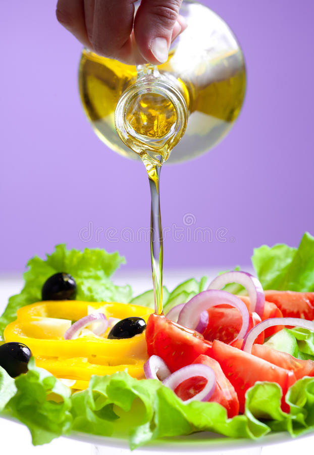 Download Olive Oil Stream And Healthy Fresh Vegetable Salad Stock Photo - Image: 20416292