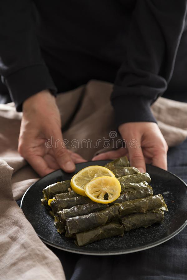 Olive oil stuffed leaves on the plate. With vegetable and lemon for service for restaurant concept from Turkey stock image
