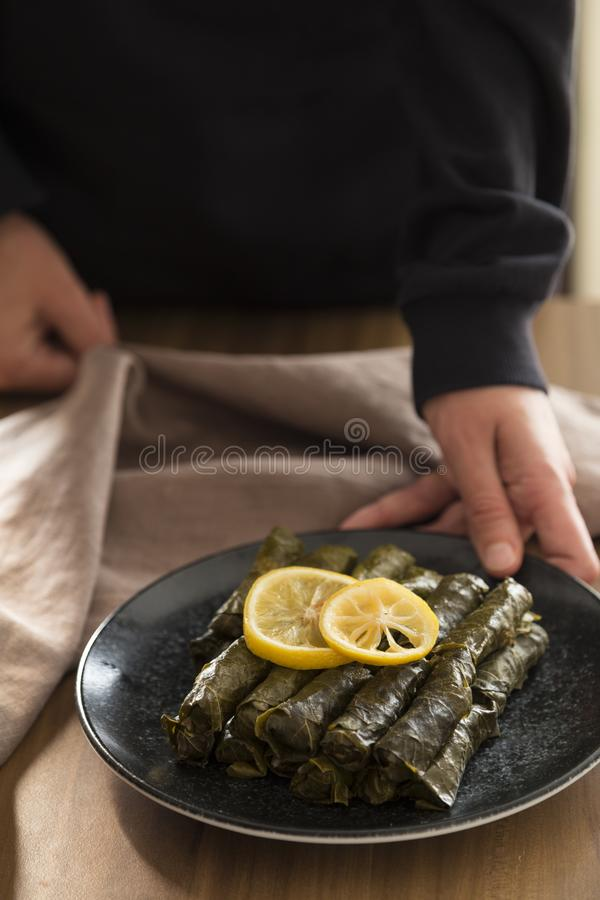 Olive oil stuffed leaves on the plate. With vegetable and lemon for service for restaurant concept from Turkey royalty free stock photos