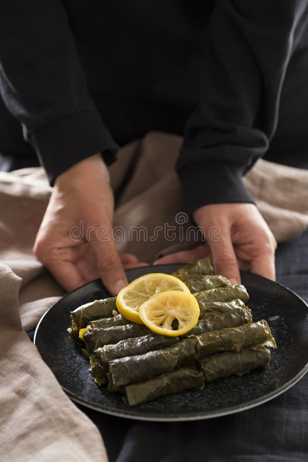 Olive oil stuffed leaves on the plate. With vegetable and lemon for service for restaurant concept from Turkey royalty free stock photography