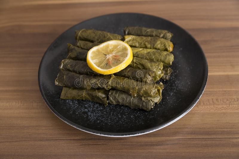 Olive oil stuffed leaves on the plate. With vegetable and lemon for service for restaurant concept from Turkey stock photo