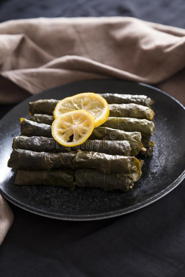 Olive oil stuffed leaves on the plate. With vegetable and lemon for service for restaurant concept from Turkey stock photos