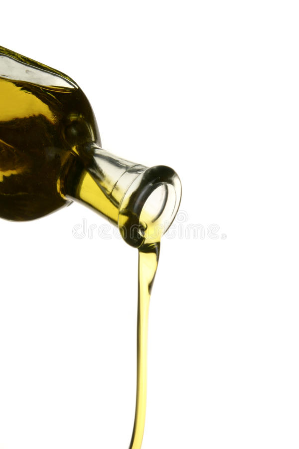 Olive oil trickle from bottle royalty free stock images