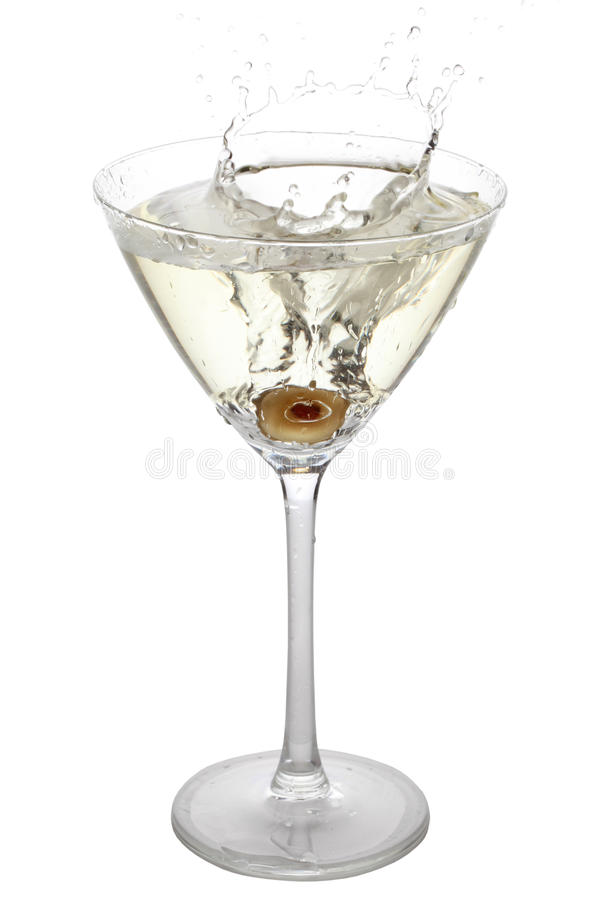 Olive splashing into a cocktail glass stock images