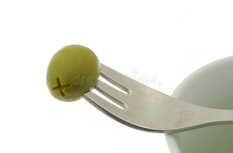 Olive stuck on a fork royalty free stock photos