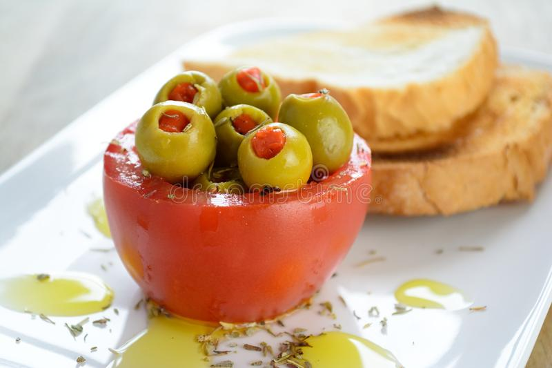 Olive stuffed tomato