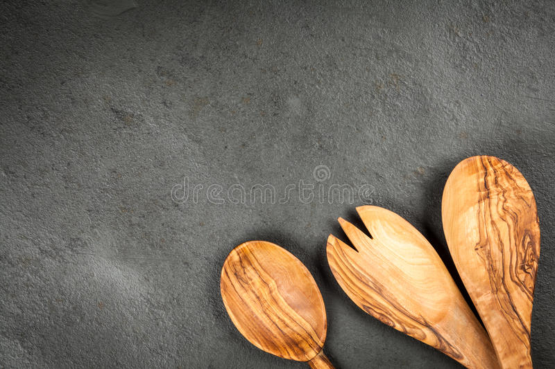 Olive wood spoons. On dark background royalty free stock images